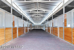 Two first class 16 stall barns with rubber flooring. Two large paddocks. Three arenas- one large and two round pens. Two hay barns. Tack rooms . Horse showers. Grain rooms. A beautiful outdoor patio with rock fireplace
