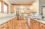 Full slab granite counters, double pane windows with wood sash, recessed lighting, lots of modern cabinet space.