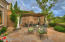 Inviting covered patio with flagstone.