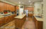 Kitchen with efficient single basin sink, large island, gas cooktop