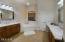 Dual separated vanities in master bath, soaking tub. High ceilings lend to spaciousness