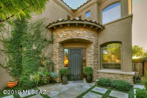 Located in the prestigious guard gated community of La Paloma.