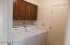 Laundry room has door to garage and then enters the kitchen.