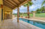Covered Patio Space Overlooking Pool