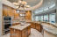 Island with prep sink; gas cooktop with pot filler, warming drawer, Thermador stainless appliances