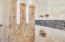 Snail shower in guest house bath