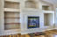 Gas fireplace with display shelves