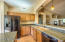 Kitchen with eng. stone counters & black appliances