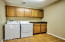 Large Laundry Room with storage cabinets. Washer & dryer inlcuded!