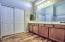 Master Bath with Double Vanities & door to walk-in closet