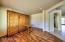Den has wood flooring and Built-in Murphy Bed/Desk