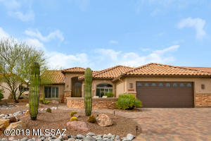 Stacked Stone Front & Patio Courtyard. Newer Exterior Paint & Freshly Painted Interior.