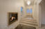 Foyer accented with natural stone and see-through fireplace
