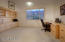 Spacious office features abundance of room, built-ins, and a peaceful mountain view