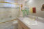 Guest bath has bright natural lighting