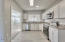 Enjoy all brand new cabinets in this Bright and Airy modern Kitchen.