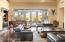 Step into the vast entertaining room. Note the beams & Brazilian walnut flooring