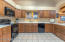 Wonderful kitchen with lots of cabinetry and counter tops.