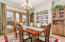 Formal dining room w/built in Knotty Alder cabinets & wine rack. Open to patio