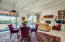 Great room with wood beamed ceiling and views from inside!