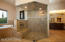 Walk in shower fully enclosed with glass