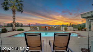 Relax by the pool and enjoy the amazing a beautiful sunsets in the privacy of your own home in Sunny Tucson AZ.