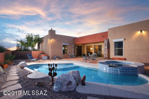 Resort like rear yard and amazing custom home.