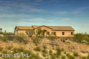 with forever views! enjoy your 3.8 acres overlooking the Christopher Columbus Part on the other side of the road to the City and entire Tucson Valley and Catalina mnts