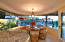 Kitchen with also overlooks sunset, pool/spa and grill.