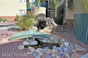 This sweet little water feature is right outside your private patio