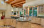 A chef's dream kitchen with extensive counter and cabinet space (including two separate islands), not to mention a separate walk-in pantry just steps away. Subzero refrigerator, gas cooktop, electric over, convection microwave and wine/drink chiller .