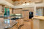 From the spacious kitchen the passage way to the right leads to the formal dining room.