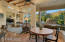 A cozy breakfast nook features large picture windows looking toward the north covered patio, outdoor fireplace and luxurious pool/spa as does the adjacent family room.