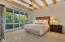 Master sleeping area with large picture windows north toward the back yard, pool and Catalina Mountains.