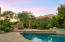 Resort-like heated pool and separate spa with adjacent fireplace/sitting area.