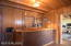 Custom bar with sink, ice bin and plenty of room to mix martinis!