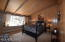 Each bedroom has high wood beam ceilings and original tongue and groove paneling