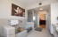 Master bath has a custom extra long tub, shower and separate vanity areas