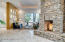 See through fireplace shows flames from 3 sides. Beautiful Travertine Floors throughout