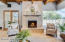 Enjoy the gas fireplace and hearth in the Great Room. Seamless windows look out to the Pool and Spa and outdoor kitchen.