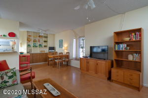 Built in shelving and cabinets in the dining area.