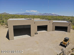Over 4,500 sq. ft. of garage space awaits here, including a very large RV garage with a 14' garage door.
