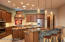 """Alder Cabinets w/Pull-Outs, 2"""" Thick Granite Counter Tops & Bertazzoni Italian Stove Top Range, Bosch Refrigerator, Double Oven & Dishwasher"""