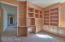 Custom built library with two desks and multiple cabinets.
