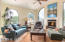 Charming Fireplace vaulted ceilings & views east. Could be your den