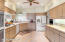 Custom cabinetry with numerous pullouts, newer appliances