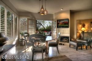 French doors in the middle lead to your private, screened-in, covered patio overlooking the majestic Catalinas. Check out the wood burning FP & the plantation shutters which are on all windows.