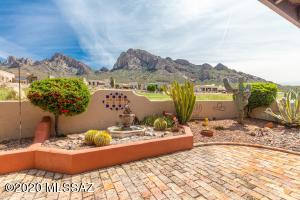 Stunning views of Pusch Ridge! Water fountain and pristine landscaping make this a super sweet spot!