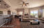 Feels like a great room with kitchen, family room and dining area all open to one another and desert vistas & city lights views at night.