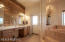 So gorgeous and inviting! Custom refinished cabinetry and wood accent wall, quartz countertops, new mirrors, hardware and lighting.
